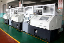 CNC-Drehmaschine / 3-Achsen / mit automatisiertem Be- und Entladen / pro Platte