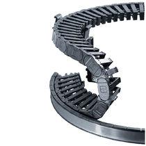 Energieführungskette / aufklappbaren Kettengliedern / Kunststoff / modulierbar / für Kreis und Spiralbewegungen