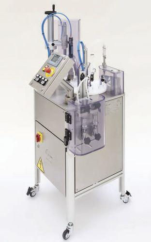 Füll- und Verschraubmaschine / für Flaschen / halbautomatisch / für Parfüm / volumetrisch