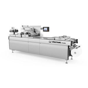Rollen-Thermoformmaschine / für Verpackung unter Schutzatmosphäre / automatisiert / Industrie