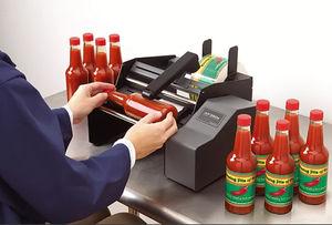 manueller Etikettierer / halbautomatisch / für selbstklebende Etiketten / für Flaschen